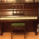 Emerson upright overstrung piano. Oak casing. Free to good home along with piano stool